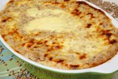 Baked buckwheat mash in baking pan Royalty Free Stock Images
