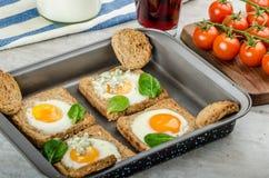 Baked Bull's-Eye Eggs Stock Photo