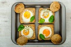 Baked Bull's-Eye Eggs Stock Image