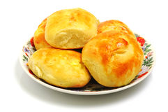 Baked buns on a plate Stock Images