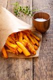 Baked butternut squash fries with sea salt, pumpkin chips royalty free stock photography