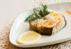 Baked cad. Served with lemon and dill Royalty Free Stock Photos