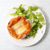 Baked camembert. And fresh salad Royalty Free Stock Photos