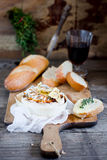 Baked Camembert cheese. With bread and a thyme Royalty Free Stock Image