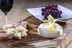 Baked camembert. Camembert cheese with bread served on a plate Stock Photos