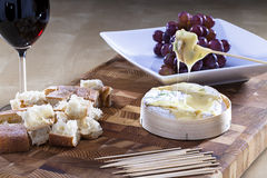 Baked camembert. Camembert cheese with croutons served on a platter Stock Photo