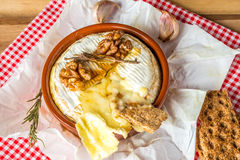 Baked Camembert cheese. With Honey, Garlic and Rosemary Stock Image