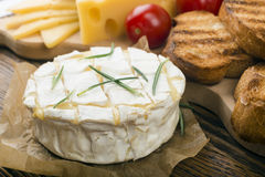 Baked Camembert cheese with rosemary Royalty Free Stock Image