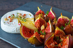 Baked Camembert with figs Royalty Free Stock Image