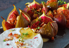 Baked Camembert with figs Stock Images