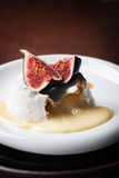 Baked Camembert with fresh figs and honey on a wooden background Stock Photos