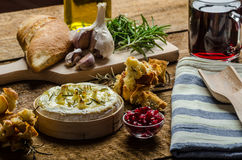 Baked Camembert with Garlic & Rosemary Stock Photography