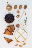 Baked Camembert with Plum Jam, Toast and Walnuts. On a White Background Royalty Free Stock Photo