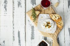 Baked camembert with toasts and thyme stock photo