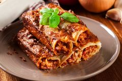 Baked cannelloni with minced meat and bechamel sauce on a plate Stock Photo
