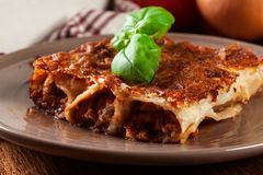 Baked cannelloni with minced meat and bechamel sauce on a plate Stock Image