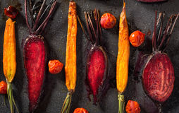 Baked carrots and beets with tomatoes Royalty Free Stock Photo