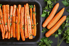 Baked carrots with green herbs Royalty Free Stock Photos