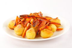 Baked carrots and potatoes. Royalty Free Stock Photography