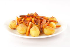 Baked carrots and potatoes. Stock Photo