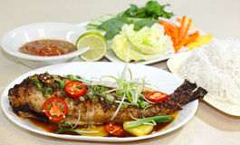Baked Catfish. Catfish baked with oyster sauce and herbs, Vietnamese cuisine royalty free stock photo
