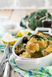 Baked cauliflower and broccoli with a sauce of tahini in a white ceramic plate Stock Image
