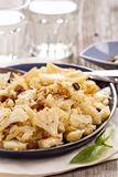 Baked cauliflower with capers and raisins Stock Image