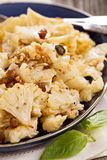 Baked cauliflower with capers and raisins Stock Photos