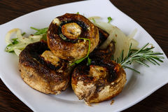 Baked champignons Stock Photos