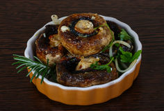 Baked champignons. With rosemary and onion rings abd parsley Stock Images