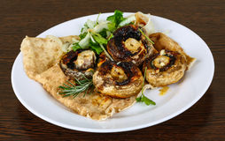 Baked champignons. With rosemary and onion rings abd parsley Stock Photography