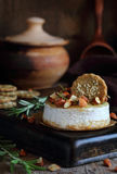 Baked cheese with almonds, rosemary, honey and crackers Stock Photos