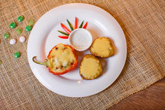 Baked with cheese and bell pepper stuffed potatoes Royalty Free Stock Image