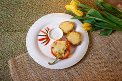 Baked with cheese and bell pepper stuffed potatoes Stock Photo