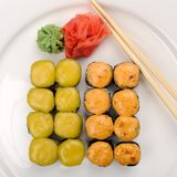 Baked cheese rolls set with wasabi and ginger on white plate wit Stock Image