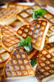 Baked cheese waffles with powdered sugar Stock Photos