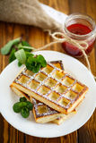 Baked cheese waffles with powdered sugar Stock Image