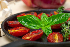 Baked cherry tomatoes with basil and thyme Royalty Free Stock Image
