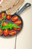 Baked cherry tomatoes with basil and thyme Royalty Free Stock Photo