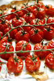 Baked cherry tomatoes. On a sheet of baking paper Stock Image