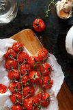 Baked cherry tomatoes. On a sheet of baking paper Royalty Free Stock Image