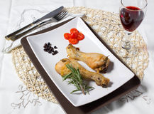 Baked chicken. On table with wine Stock Images