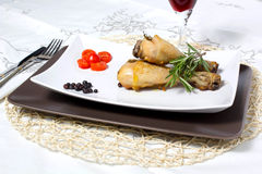 Baked chicken. On table with wine and tomatoes with spices Royalty Free Stock Photo