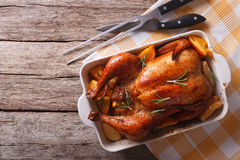 Baked chicken with apples in the baking dish. Horizontal top vie Stock Image