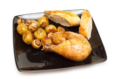 Baked chicken, bread and potatoes Stock Photo