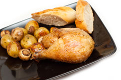 Baked chicken, bread and potatoes Stock Photos