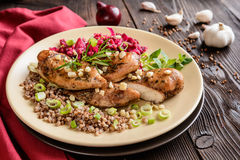 Baked chicken breast with buckwheat, beetroot and onion Stock Image