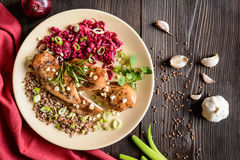 Baked chicken breast with buckwheat, beetroot and onion Stock Images