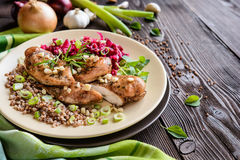 Baked chicken breast with buckwheat, beetroot and onion Royalty Free Stock Photo