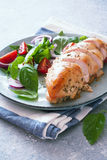 Baked chicken breast and fresh basil and tomatoes salad Royalty Free Stock Images
